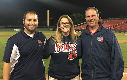Molly Snyder (center) with her supervisors at Campanelli Stadium, home to the Brockton Rox.