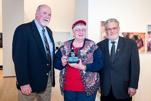 Distinguished Alumna Award Winner Susan Wells with Alumni Association member Mike Cavanaugh (left) and Sage President Chris Ames (right).