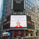 The Reuters billboard in Times Square in New York City with a tribute to Gertrude B. Hutchinson.