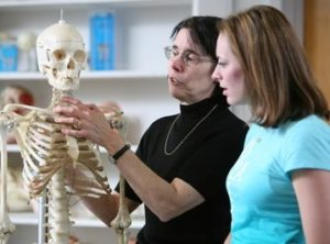 Dr. Mary Rea with a student.
