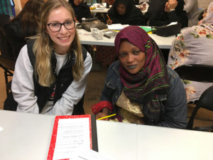 A Sage student and English language students at the Refugee Welcome Center in Albany.