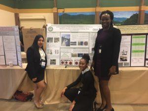 Jessica Perez '19, Naya Green '21 and Professor Emilly Obuya