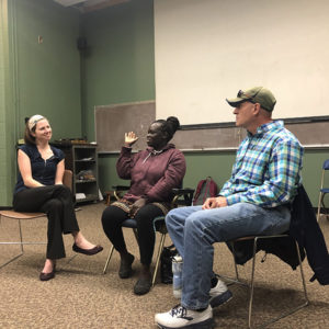 Director of Service Learning Alison Schaeffing interviews visitors from the Refugee Welcome Center during a Public Speaking class.