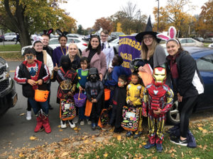 Sage students lead a Trunk or Treat activity for children at the Refugee Welcome Center in October, 2019.