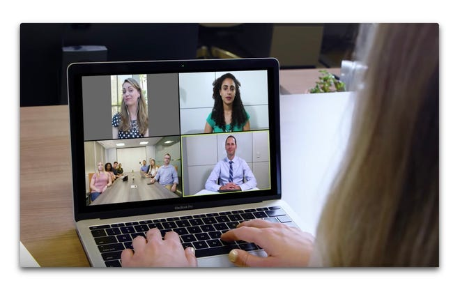 laptop screen showing multiple video chat participants
